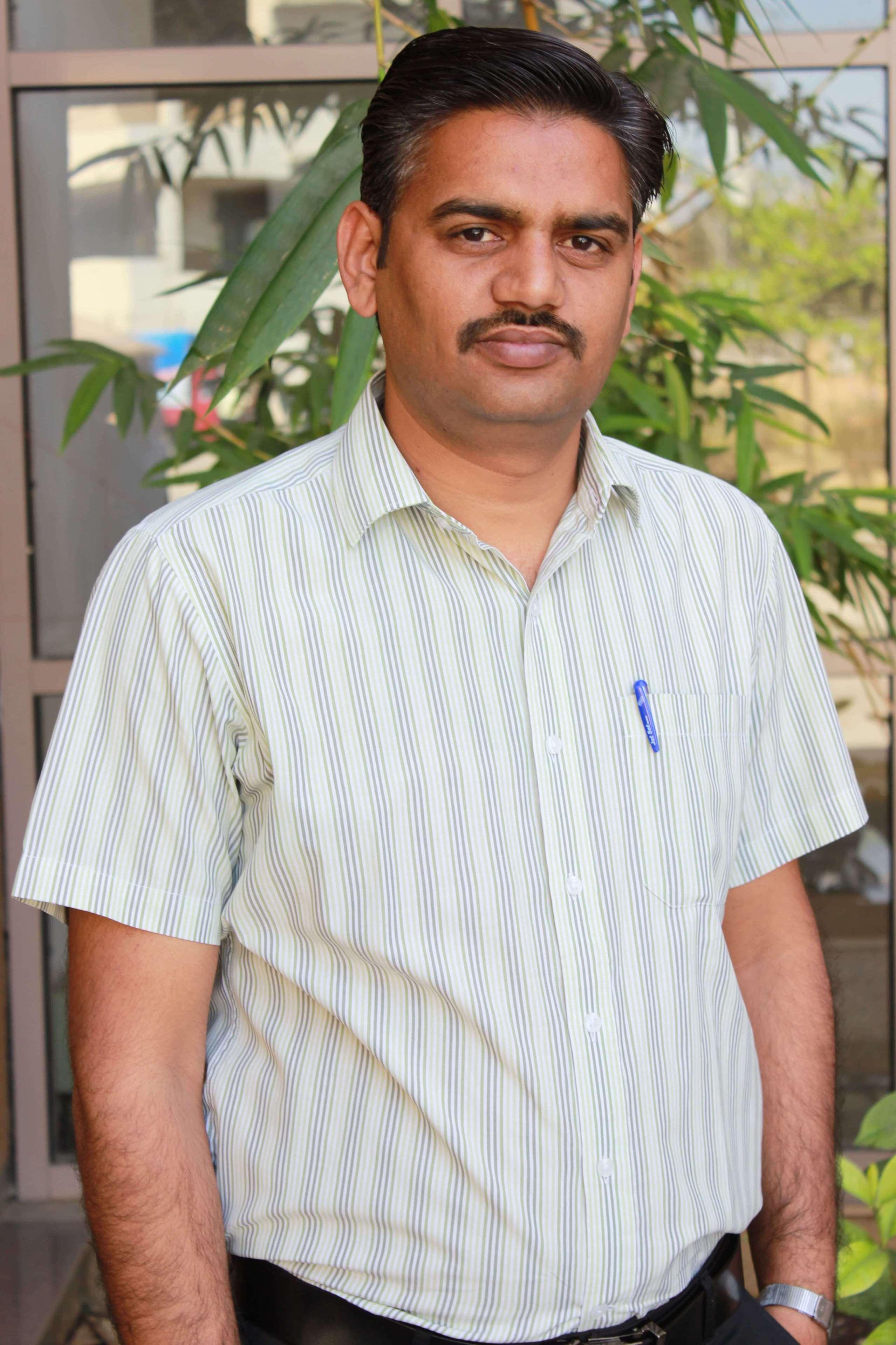 Dr.  Sharma Ravi
